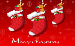 Three red christmas stockings Royalty Free Stock Photo