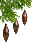 Three red christmas toys on fir tree Royalty Free Stock Images