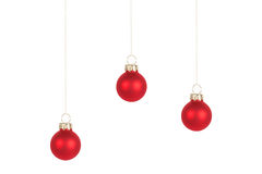 Three red Christmas tree balls, isolated Royalty Free Stock Photography