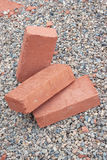 Three red clay bricks Stock Photos