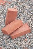 Three red clay bricks Stock Photos