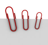 Three red clips. 3d render on white Royalty Free Stock Image