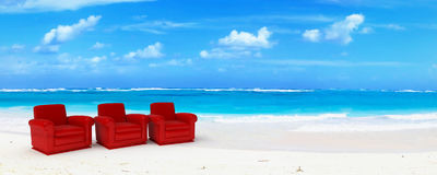 Three red club sofas in paradise Royalty Free Stock Photos
