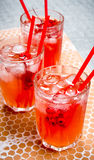 Three red cocktail with ice and straws . Royalty Free Stock Photo