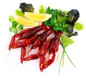 Three red crayfish with salad on white background, close up Stock Photo