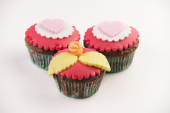 Three red cupcakes Stock Photography
