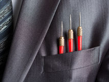 Three red darts in businessman suit pocket Royalty Free Stock Photography