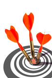 Three red darts in a dart board Stock Photography