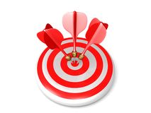 Three red darts hit the bull's eye on a target Stock Image