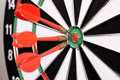 Three red darts in the target center Royalty Free Stock Image