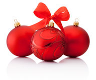 Three Red decorations Christmas ball with ribbon bow Isolated Stock Photography