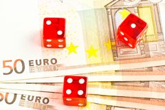 Three red dice on the  50-euro banknotes. View from top of three red dice on the  50-euro banknotes Royalty Free Stock Photos