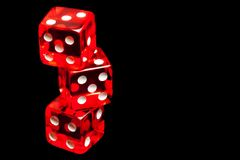 Three red dice on black background Royalty Free Stock Images