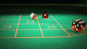 Three red dice rolling on green game gambling table on black background, shooting with slow motion, concept of sport recreation stock video