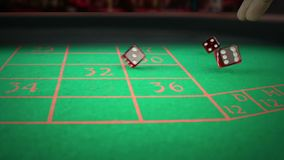 Three red dice rolling on green game gambling table on light disco, shooting with slow motion, concept of sport recreation leisure stock footage