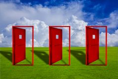 Three Red door placed on an outdoor lawn with blue sky floor. Concepts, ideas, choices, and business decisions royalty free illustration