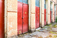 Three red doors bearing a danger label Royalty Free Stock Images