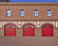 Three red doors and four windows, fire squad station, Germany Stock Image