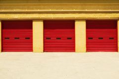 Three Red Doors in a Yellow Building Royalty Free Stock Photos