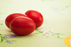 Three red eggs Stock Images