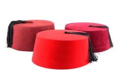 Three red fezzes Stock Photo