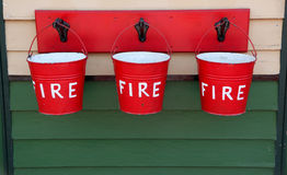 Three Red Fire Buckets Royalty Free Stock Photography