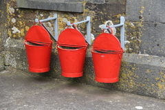 Three red fire buckets Royalty Free Stock Image