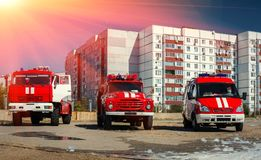 Three red fire truck at sunset. Royalty Free Stock Photos