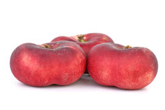 Three red flat peaches Stock Photo