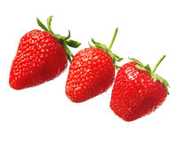 Three red fresh strawberries isolated Royalty Free Stock Photography