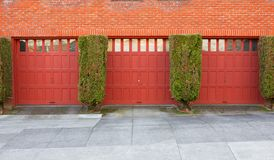 Three Red Garages Royalty Free Stock Photo