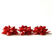 Three red gift bows Stock Photos