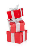 Three red gift boxes with silver ribbon and bow. Isolated on white background Stock Images