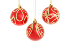 Three red and gold Christmas baubles Stock Images