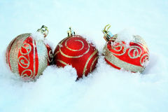 Three red and gold Colorful Christmas balls in snow Stock Photography