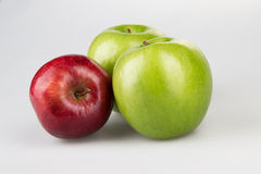 Three red and green apples Royalty Free Stock Photo