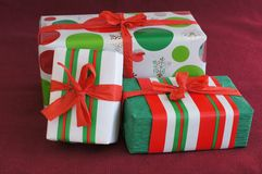 Three red-green-white Christmas gifts Stock Image