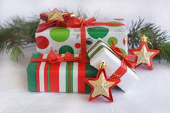 Three red-green-white Christmas gifts with red-gol Royalty Free Stock Photos