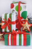 Three red-green-white Christmas gifts with red-gol Stock Photography