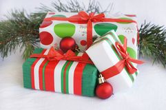 Three red-green-white Christmas gifts with red orn Royalty Free Stock Images