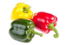 Three red,  green and yellow bell peppers Royalty Free Stock Photography