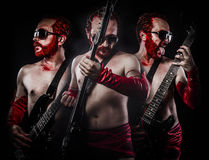 Three red haired man performing electric guitar, heavy metal con. Cept, art Stock Image