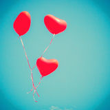 Three Red Heart-shaped balloons Royalty Free Stock Images