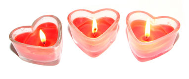 Three red heart shaped candles Stock Images