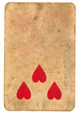 Three red heart symbol on old playing card paper background Stock Photography