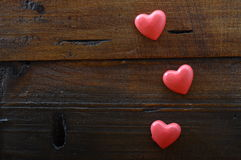 Three red heart on wooden background Royalty Free Stock Photo
