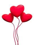 Three red hearts-balloons Stock Photo