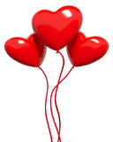Three red hearts-balloons Stock Images