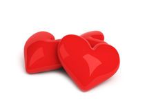Three red hearts over white. Background Stock Photos