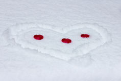 Three red hearts in  snow heart Royalty Free Stock Photos